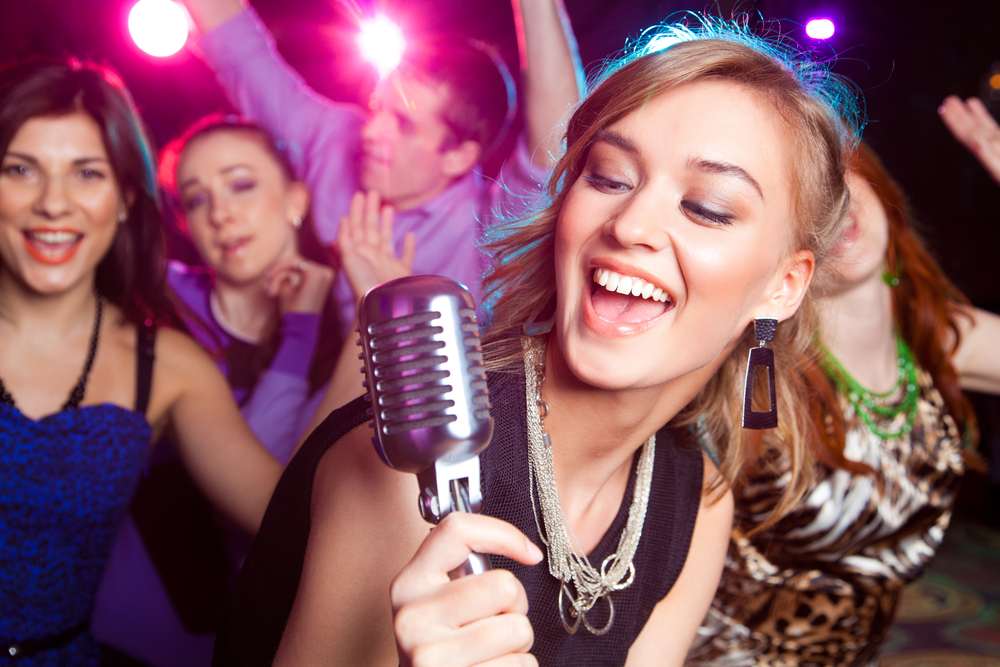 Create A Karaoke Party Powerhouse at Home with Your Stereo System singer