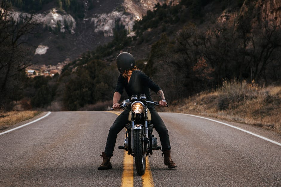 6 Things You Should Know While Traveling on Your Motorcycle looking back